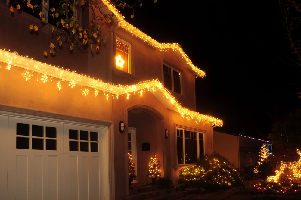 Garage Door and front of home lit for Christmas