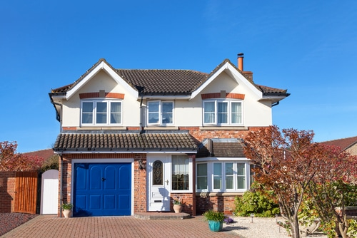 House in Gloucestershire with a blue garage door