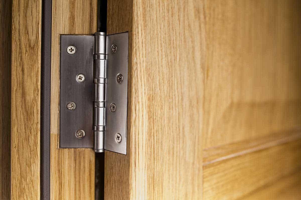 Wooden door with silver hinge