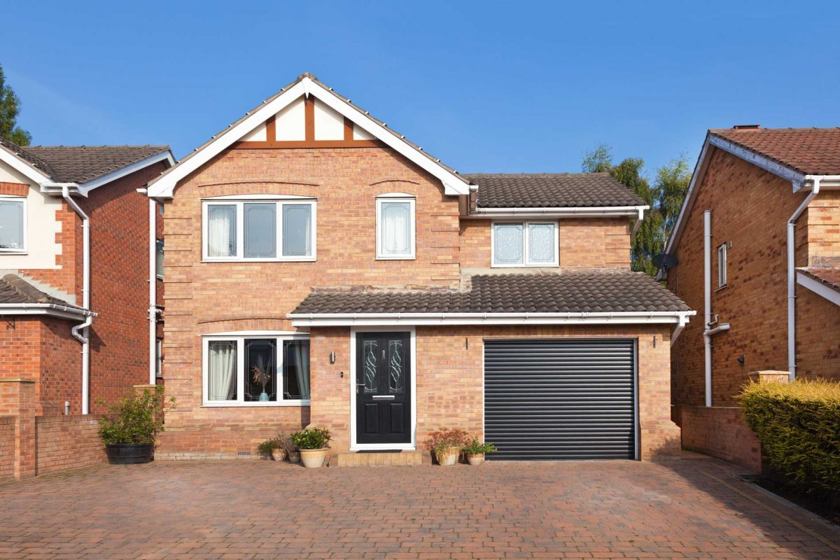 Front of house with garage door supplied by Abacus